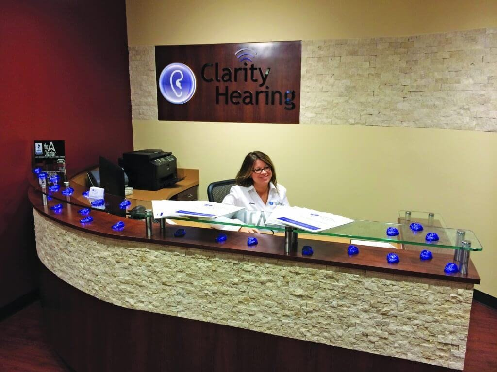 Krissy front office at desk
