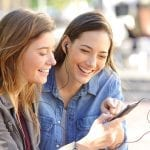 Young teenage girls listening to music | Clarity Hearing