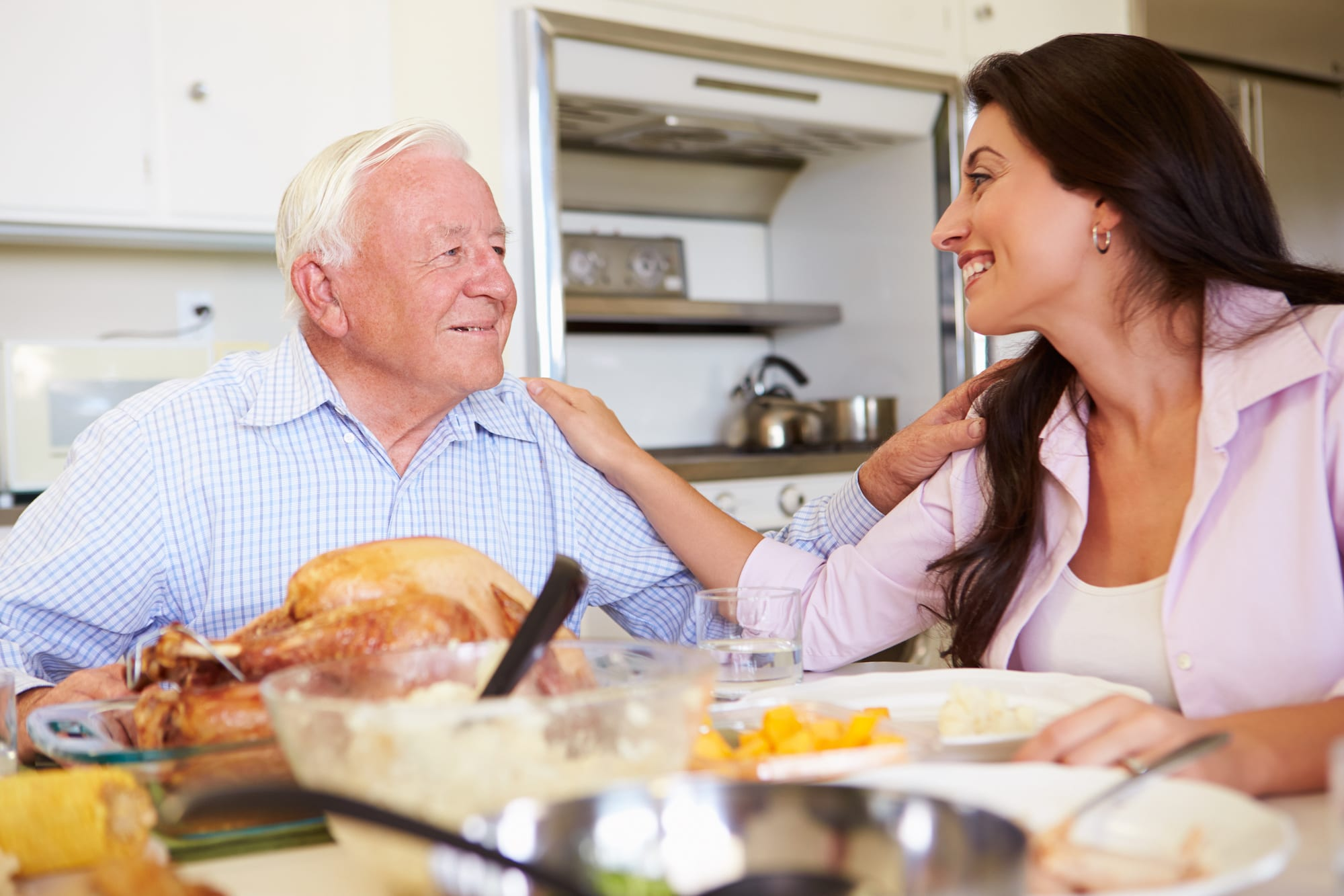 Father And Adult Daughter Having Family Dinner At Table | Clarity Hearing