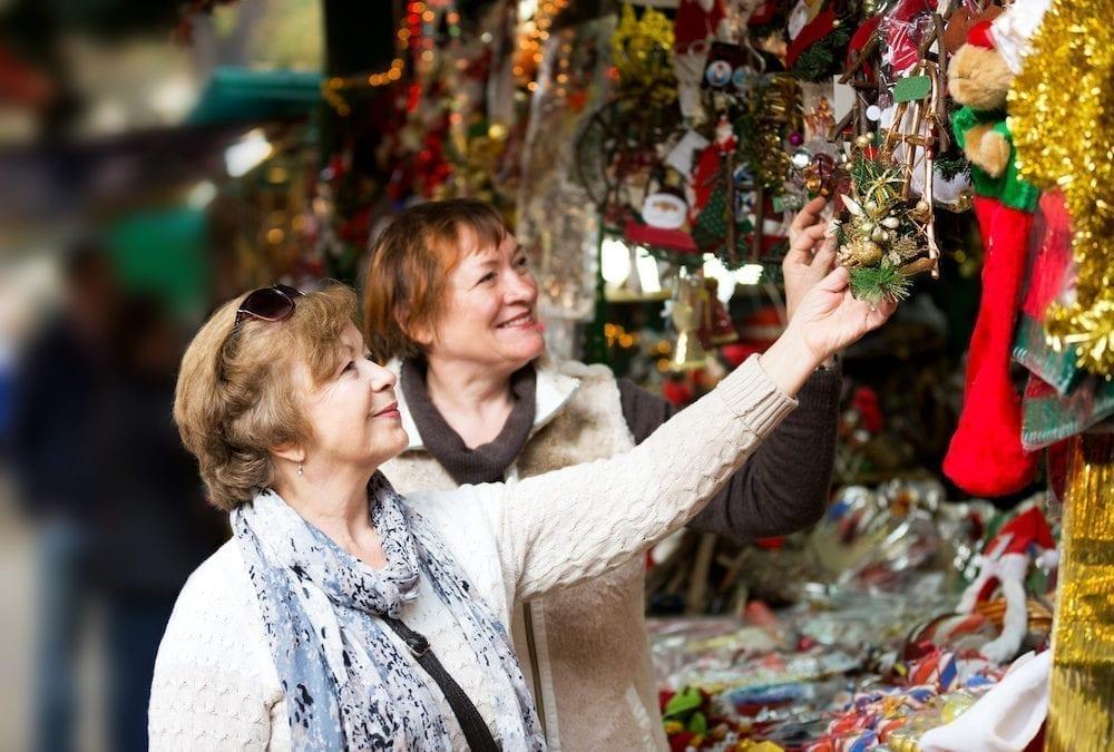 Happy mature women purchasing Christmas decorations | Clarity Hearing