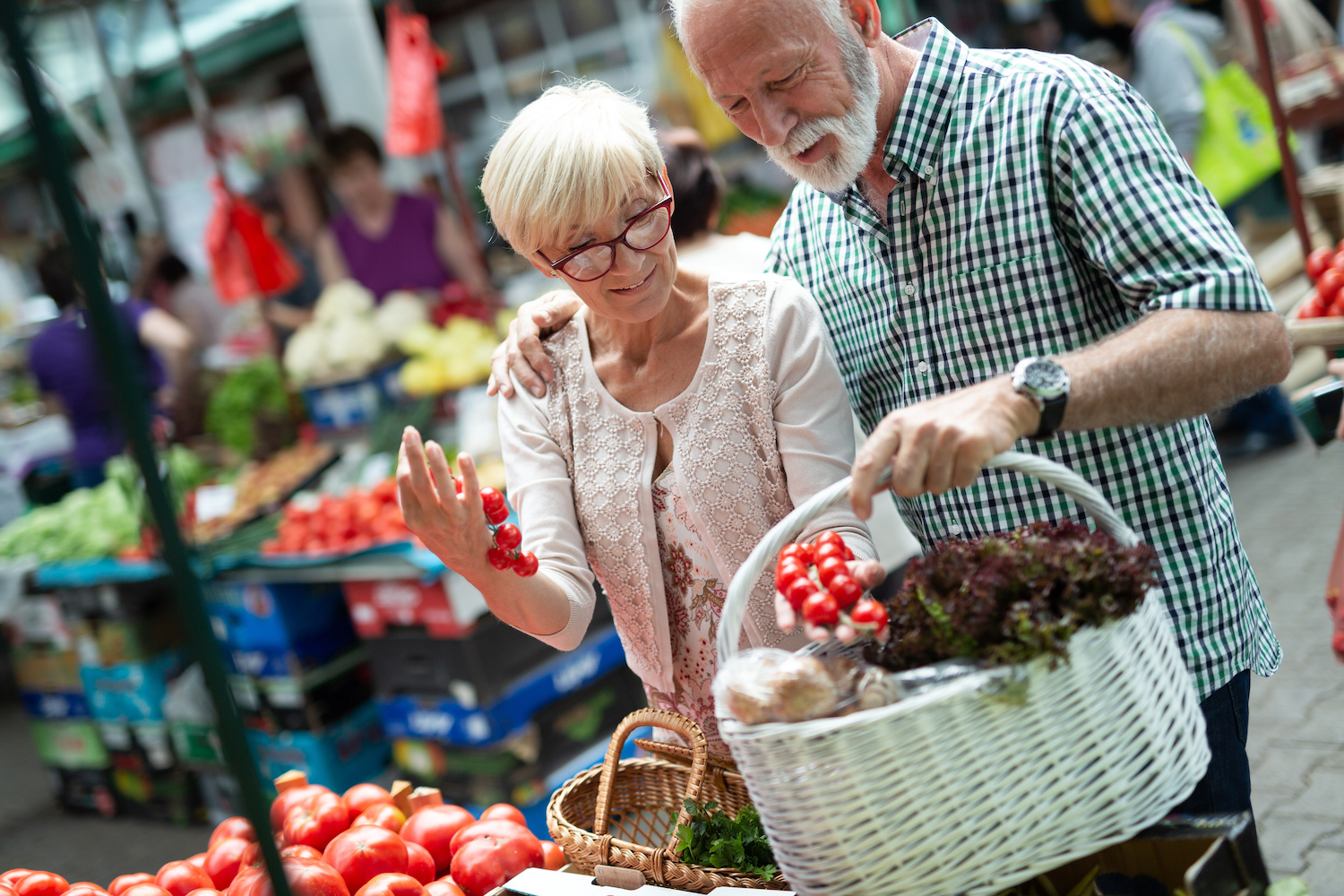 Senior shopping couple with basket on the market. Healthy diet.   Clarity Hearing